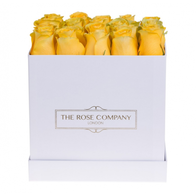 Square white box with yellow roses