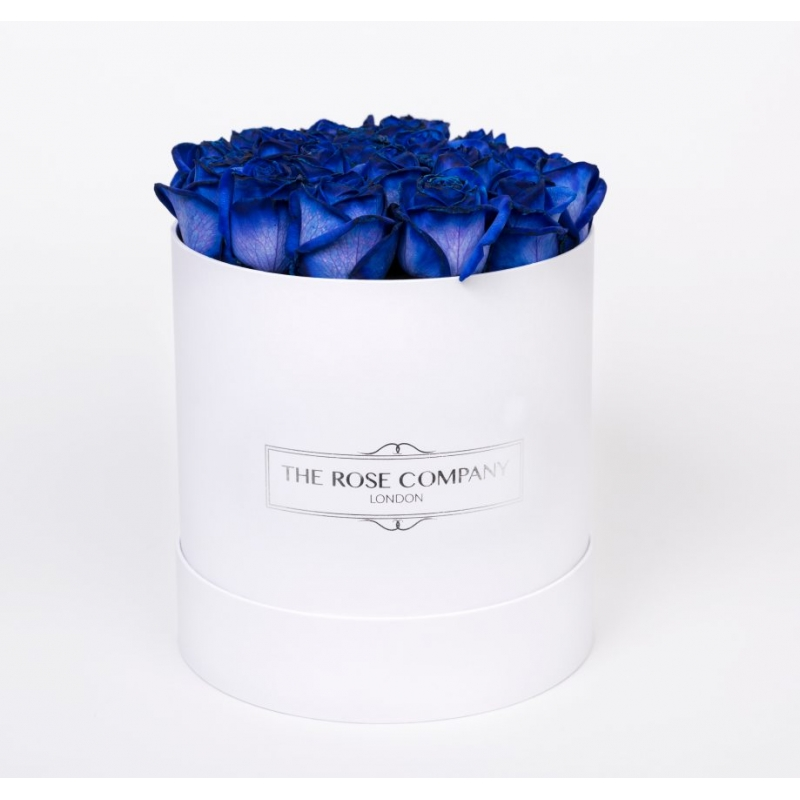 Small round high white box with blue roses