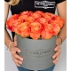 Small round low grey box with orange crush roses